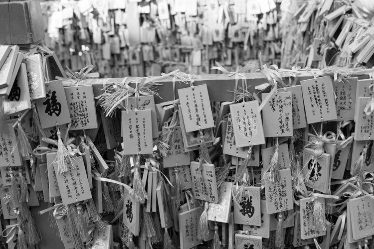Close-up of padlocks hanging on bridge