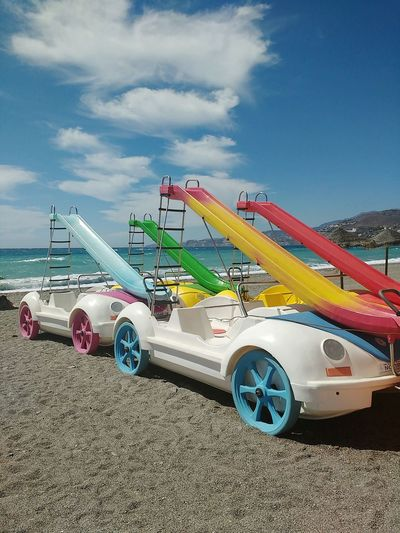 Slide Transportation Outdoors Multi Colored Beach Nature Sky Day Car Beetle Car Vacation Water Cart Water Activities Fun Playtime Pedalo Pedal Boat Pedalo With Slide Pedal Boats Water Slide Summer Beach Time Happy Kids Toys