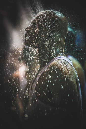 Side View Of Man Taking Shower At Batu Caves