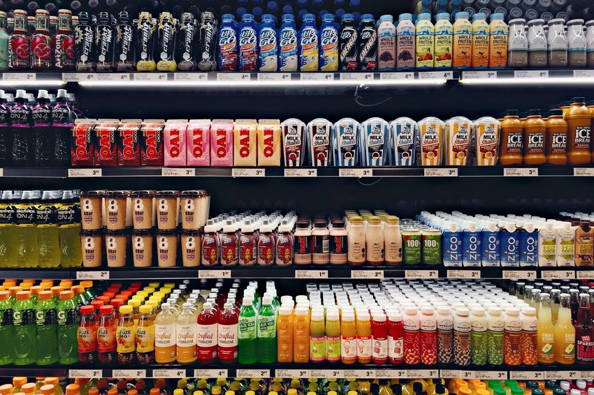 Pristine supermarket shelves on opening day. Supermarket Repetition
