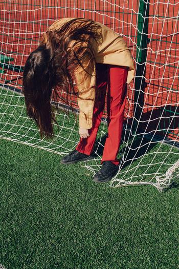 Woman standing on soccer field