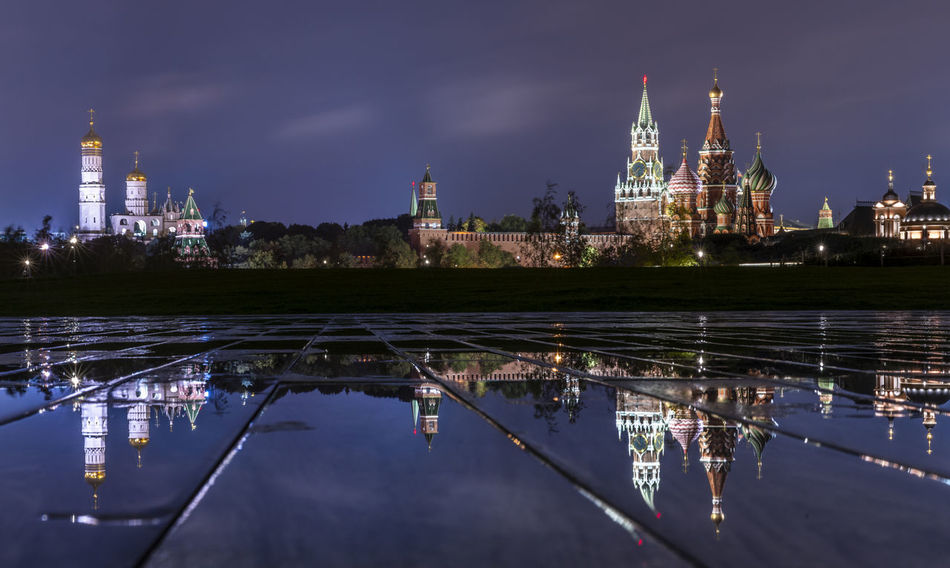 Saint Basil's Cathedral and Kremlin reflection Kremlin Moscow Orthodox Church Russia Architecture Building Building Exterior City Citylights Cityscape Illuminated Night No People Orthodox Place Of Worship Reflection Saint Basil's Cathedral Sky Spire  Tourism Travel Destinations Water