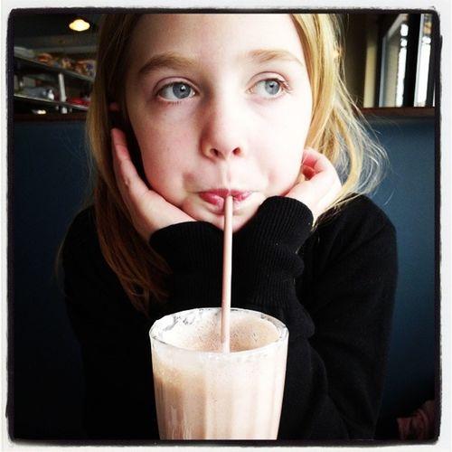 Little Girl Looking Away While Drinking Milkshake
