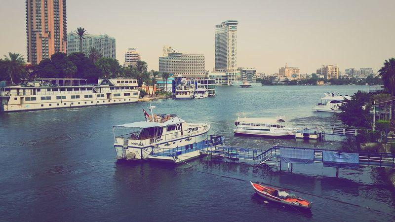 River Nile's busy life. ❤ River Nile Riverbanks Yachts Boats Skyscraper Cityscape Travel Destinations Heart Of Cairo Cairo AHLY  ConradHotel Opera House Zamalek .. <3 zamalek Zamalek City Egyptdailylife Egypt Finding New Frontiers