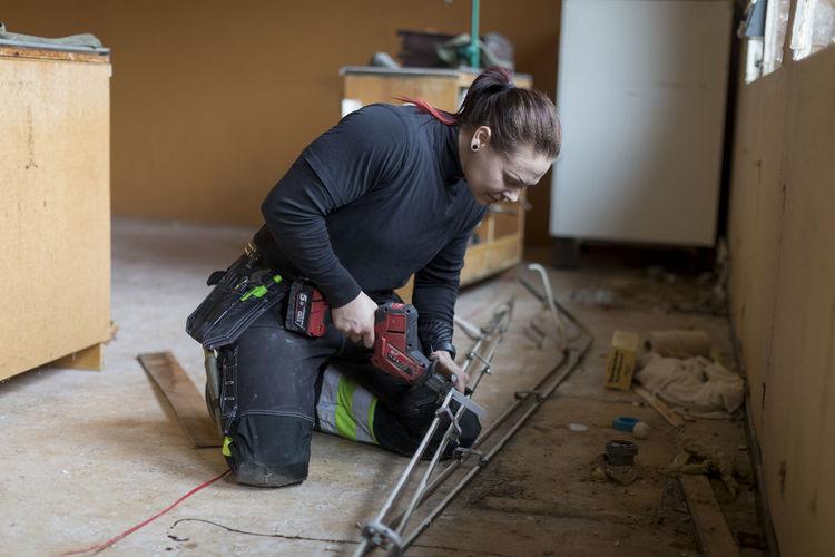 Man working on floor in building