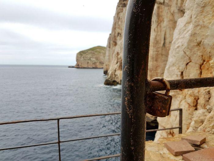 Padlock Perspective Soft Focus Sea Sassari Blue Wave Sea And Rocks Rust Sardinia Nature_collection Sardegna Cerdeña