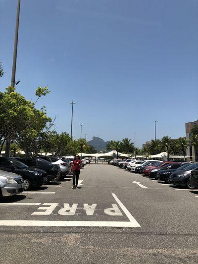 Traffic on city street against clear sky