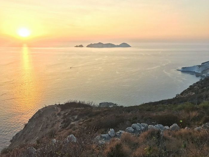 Sea Sunset Nature Rock - Object Beauty In Nature Scenics Tranquil Scene Sun Outdoors Horizon Over Water Tranquility Water No People Beach Sky Italy Ponza Palmarola
