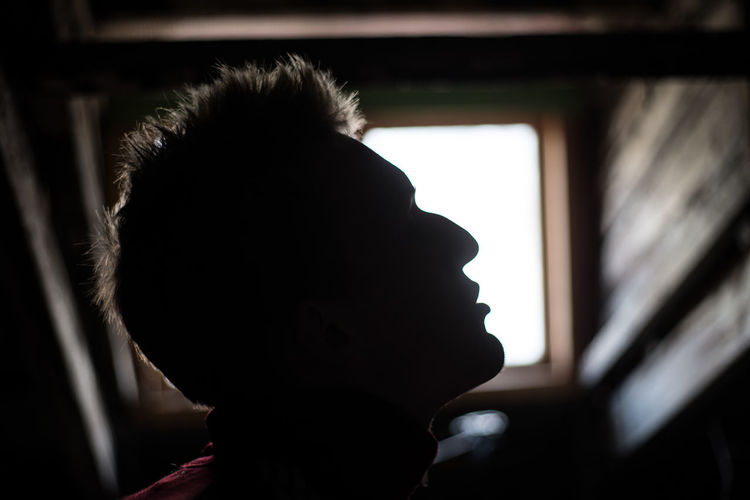 One Person Indoors  Real People Lifestyles Men Body Part Young Adult Young Skin Mood Depression - Sadness Depression Depressive Headshot Portrait Silhouette Window Leisure Activity Obscured Face Hairstyle Childhood Child