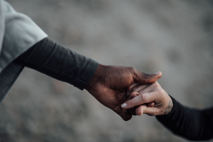 Close-up of man holding hands