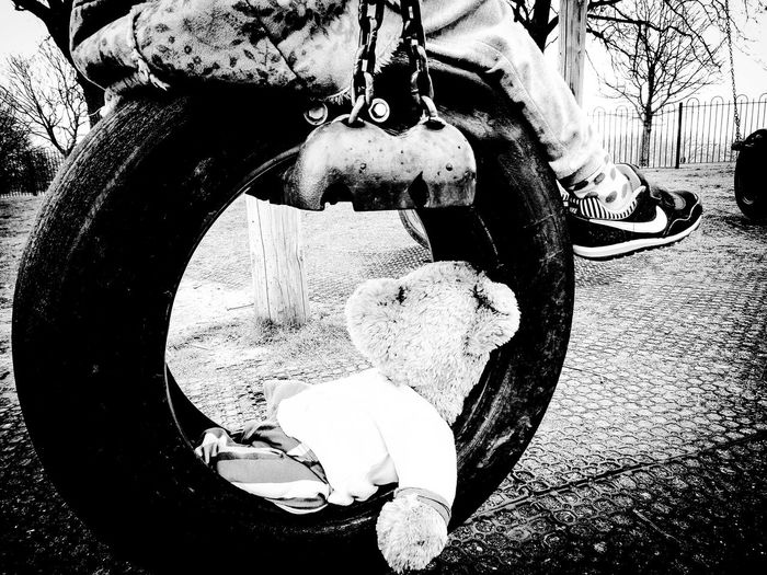Teddy tyre. Close-up No People Backgrounds Outdoor Photography EyeEm Gallery Fresh On Eyeem  Ayeshea Bah Tranquil Scene Textured  Black & White Photography Teddy Bear 🐻 Tyre Swing Kids Being Kids Park Life Winter Kids At Play Kids Of EyeEm Climbing Frame Soft Toy