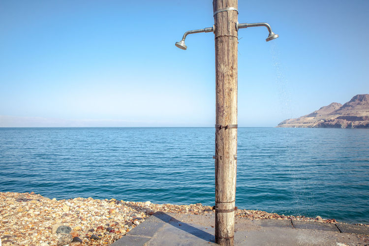 Water Sea Sky Nature No People Blue Day Clear Sky Scenics - Nature Outdoors Horizon Tranquility Horizon Over Water Beauty In Nature Dead Sea  Dead Sea View Jordan Shower Head Salt Water Street Light Tranquil Scene Street Lighting Equipment Copy Space Turquoise Colored