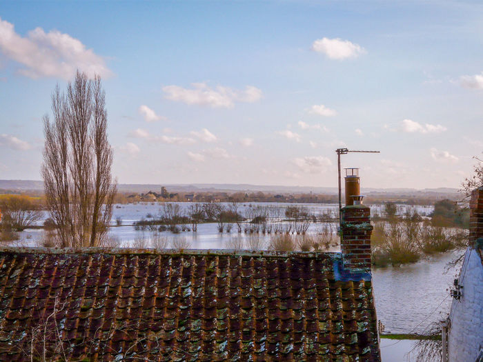 looking over roof tops towards Muchelney floods 2014 February 16th on this day Wonders Of Nature Floods 2014 Flooded Fields EyeEm Nature Lover EyeEm Best Shots Beauty In Nature Water Cold Temperature Winter Tree Snow Sky