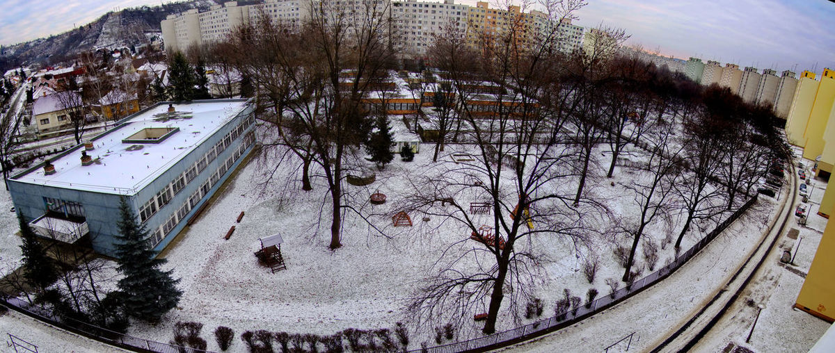 High angle view of snow covered trees against sky