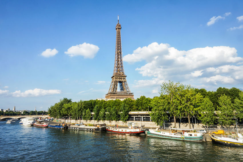 An Eye For Travel Architecture Boats Built Structure City Eifel Tower Famous Place River Sky Summer Tower Travel Destinations Travelphotography Tree Waterfront