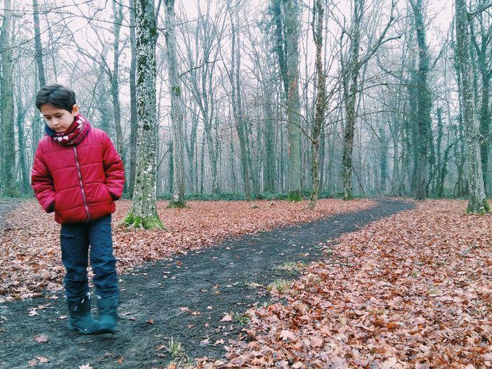Full length of man standing in park during winter