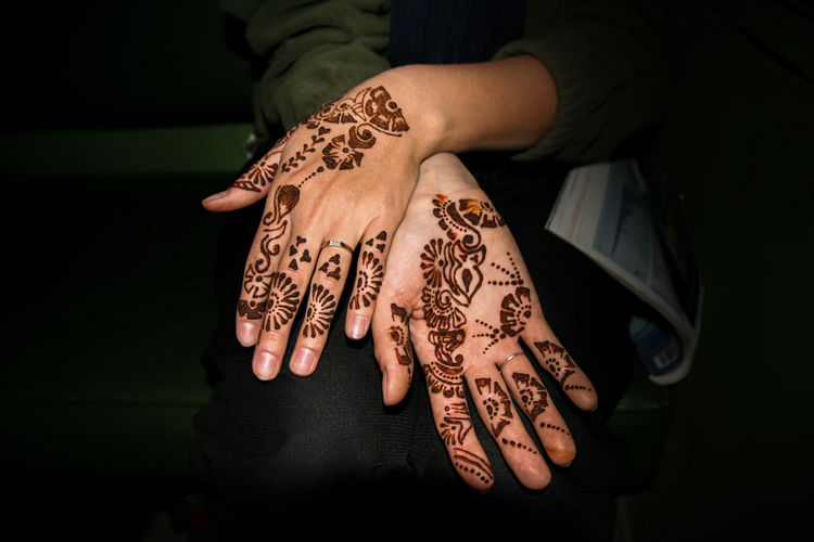 Cropped image of woman with henna tattoo