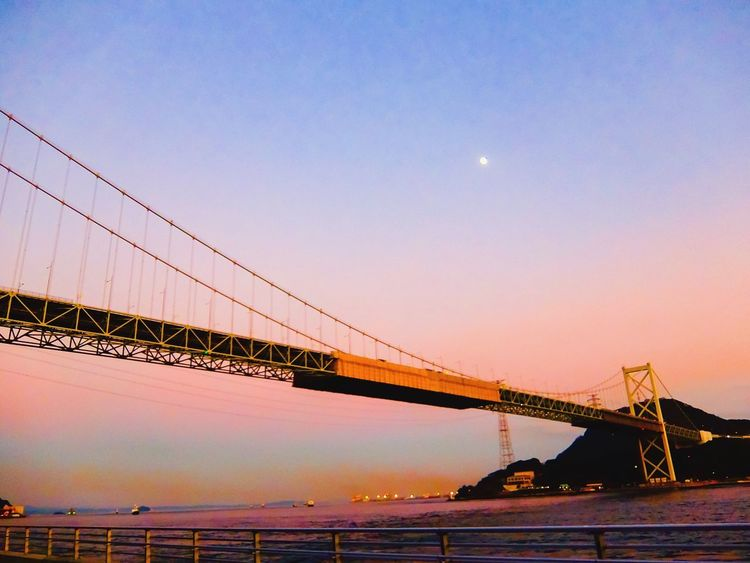 Sunset bridge Bridge - Man Made Structure Connection Engineering Transportation Suspension Bridge Moon Architecture Sky Built Structure Bridge River Water Clear Sky Travel Destinations EyeEmNewHere Tranquil Scene Tranquility Scenics Nature Night Seascape Sea And Sky Beauty In Nature EyeEmNewHere