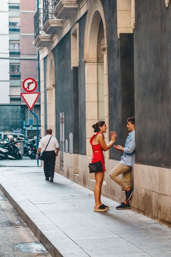 Built Structure Architecture Full Length Building Exterior Day City Men Communication Walking Women Real People Outdoors Road Sign Young Women Young Adult Lifestyles Adult Adults Only People Alicante The Street Photographer - 2018 EyeEm Awards