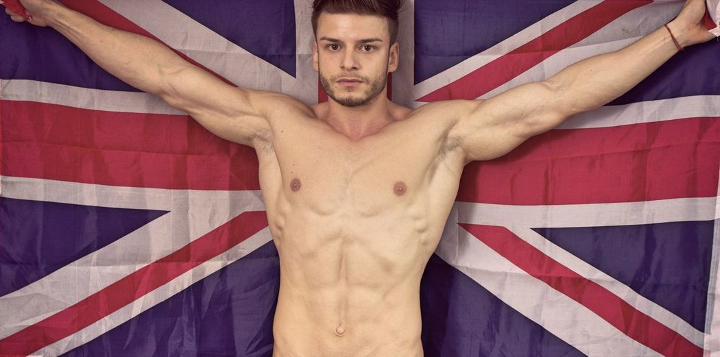 Portrait of shirtless muscular man with australian flag