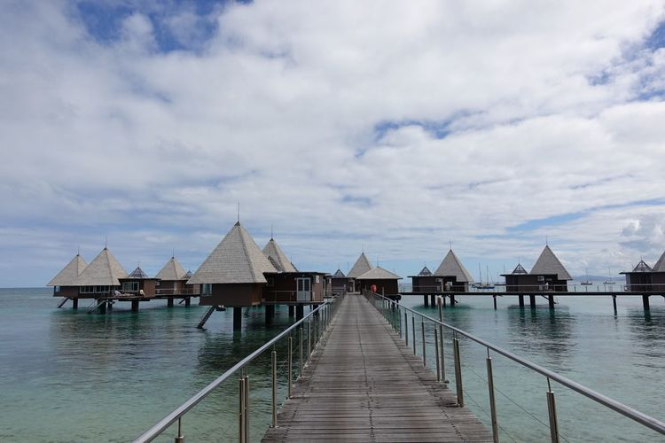 Water bungalows in New Caledonia Water Bungalows New Caledonia Oceania Melanesia Maitre Water Cloud - Sky Sky Built Structure Architecture Pier Nature No People Building Exterior Sea Building Beauty In Nature Tranquility Residential District Outdoors Tranquil Scene Scenics - Nature House