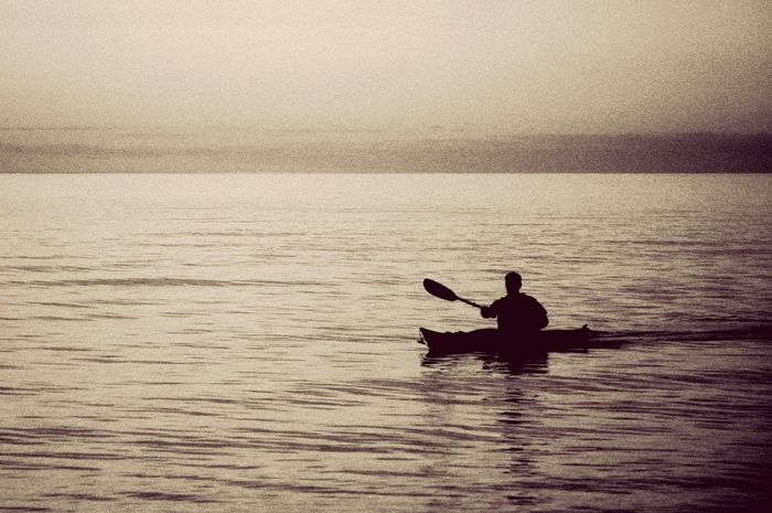 A Lake Ontario Show Me Your Sepia Water_collection Monochrome_Monday Sunset Silhouettes ... In a kayak