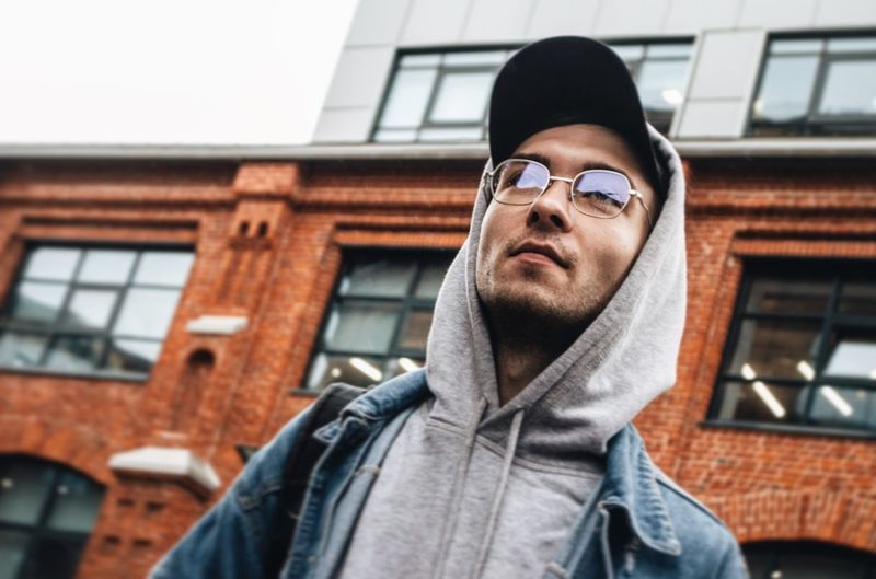 EyeEm Selects Young Adult Architecture Portrait Glasses Headshot One Person Building Exterior Young Men Lifestyles Real People Clothing Day Front View Leisure Activity Standing Low Angle View Men Fashion Hood - Clothing Built Structure