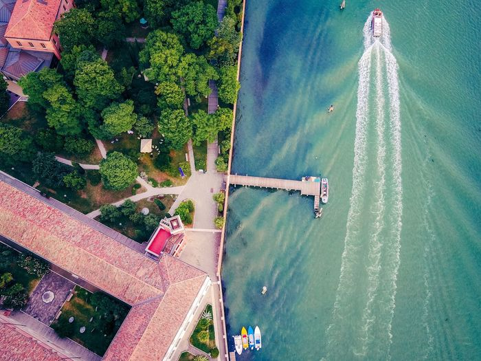 High Angle View Water Day Outdoors No People Aerial View Nature Built Structure Architecture Tree Beauty In Nature Building Exterior Irrigation Equipment Sky Lost In The Landscape Connected By Travel Dronephotography Landscape Venice, Italy Lagoon Of Venice Lagoon Boats Boats⛵️ Parking Flying