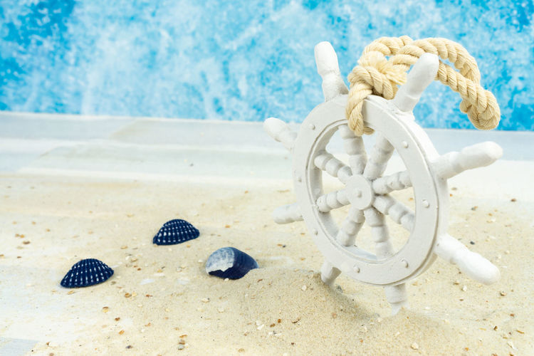 Maritime background with sand, shells and an old white wooden wheel Background Beach Wheel Ship Wooden Steering White Beautiful Nature Sand Blue Summer Decoration Holiday Marine Sea Ocean Tropical Star Shell Above Maritime Copy Space Land No People Animal Shell White Color Animal Wildlife Close-up Day Seashell Water Animal Art And Craft Sea Life Focus On Foreground Starfish  Luxury Turquoise Colored
