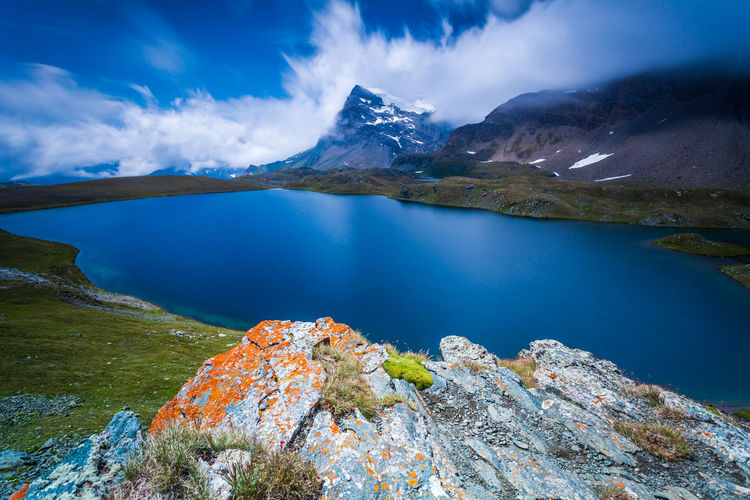 Scenic view of lake against mountains at gran paradiso national park