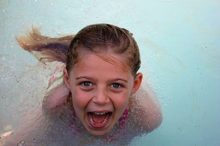 Young girl enjoying some pool time Cheerful Child Childhood Headshot Looking At Camera Portrait Smiling Swimming Swimming Pool Water Wet