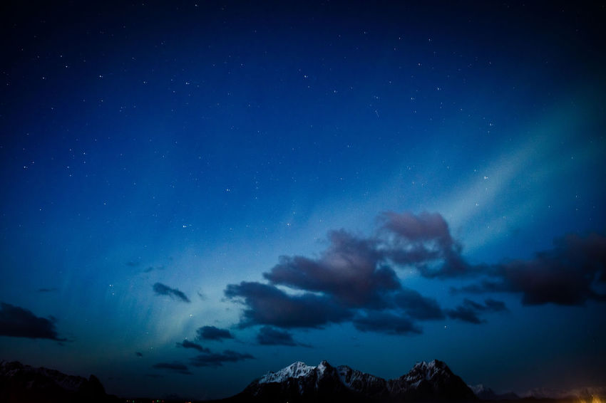 Northern Lights Norway Astronomy Beauty In Nature Blue Constellation Galaxy Lofoten Mountain Nature Night No People Outdoors Scenics Sky Space Star - Space Starry Tranquil Scene Tranquility