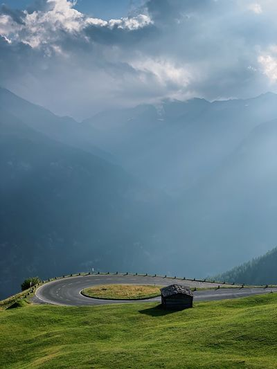 Scenic view of mountain road against sky.