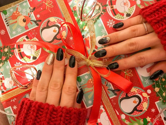 Flat Lay Bow Christmas Theme Gift Box Christmas Gift Christmas Decoration Presents Gift Wrapping Gift Wrap Gift Human Hand Hand Human Body Part Nail Nail Polish Adult One Person Women Finger Human Finger Ring Body Part Nail Art Celebration Real People Red Pattern Close-up Jewelry Fingernail