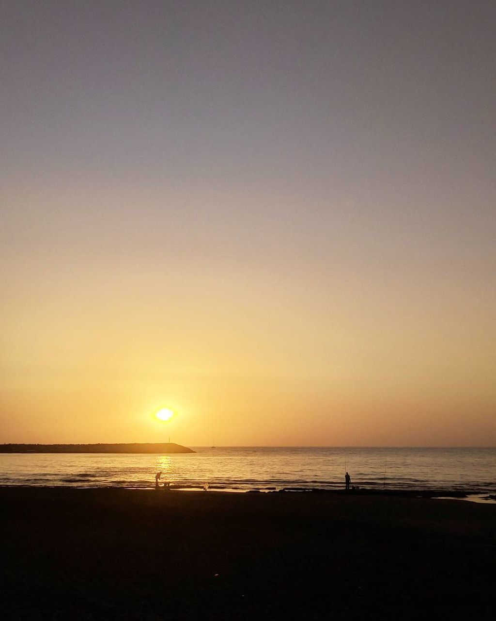sunset, sea, silhouette, beach, nature, scenics, beauty in nature, horizon over water, tranquil scene, water, tranquility, sun, sky, outdoors, vacations, no people