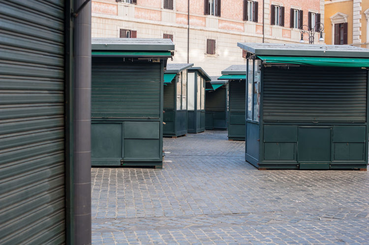 Closed stalls in urban place Architecture Building Exterior Built Structure Business Closed Crisis Day Depression Economic Crisis Green Market No People Nobody Poverty Rolling Shutter Sadness Stall STAND
