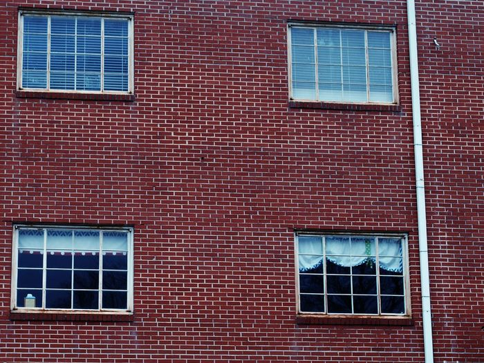 Brick Wall Building Exterior Wall - Building Feature Architecture Built Structure Window Red No People Outdoors Day Text Close-up Four Windows Alabama Fort Payne, AL Rural Scene