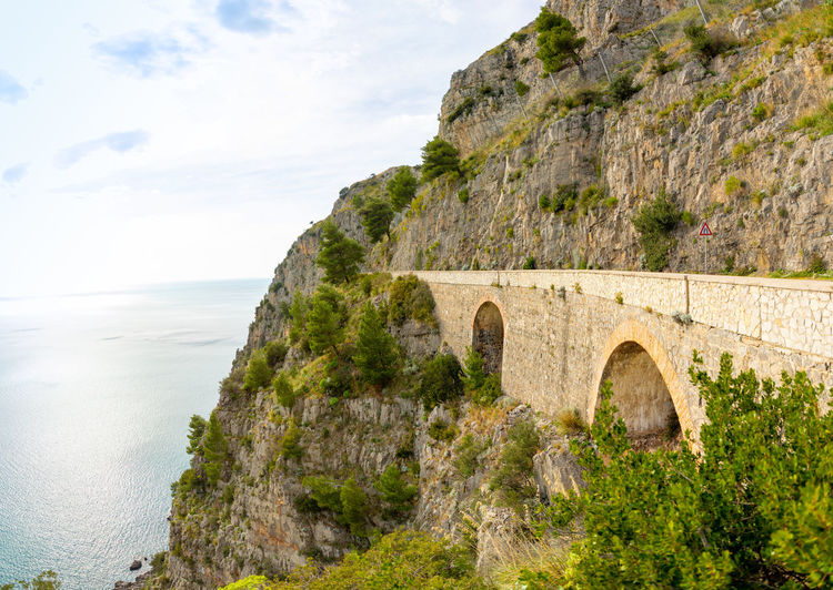 Italy Sicily Water Architecture Sky Nature Built Structure Arch Travel Destinations History The Past Scenics - Nature Sea Day Land Travel Cloud - Sky Ancient Plant Beauty In Nature No People Outdoors Stone Wall