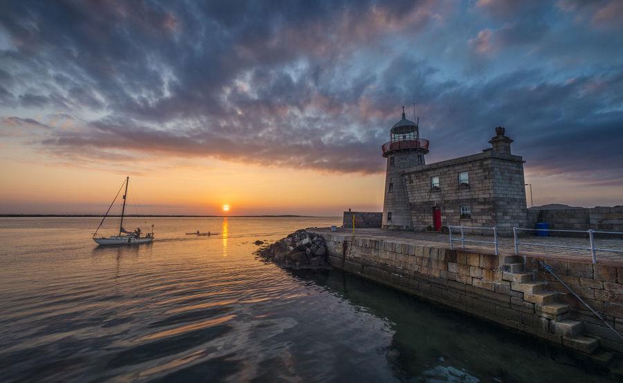 Architecture Boat Cloud - Sky Lighthouse No People Scenics Sea Sky Sun Sunset Travel Destinations Water Wave