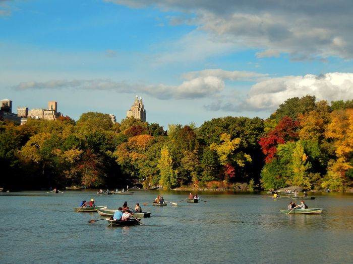 People Boating On Lake At Central Park Against Sky