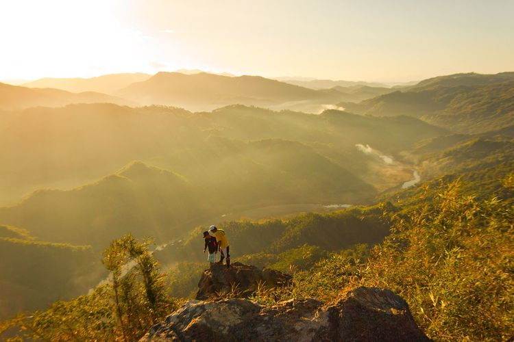 High angle view of people on mountains during sunset