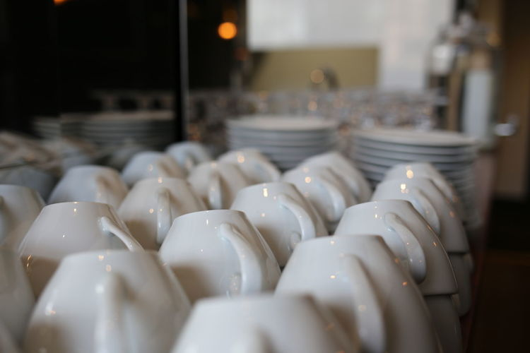 Abundance Arrangement Cafe Cafe Time Close-up Coffecup Coffecups Focus On Foreground Handles In A Row Industrial Industry Interior Large Group Of Objects No People Porcelain  Repetition Selective Focus Simplicity Still Life TeaCup Teacups Units White White Color