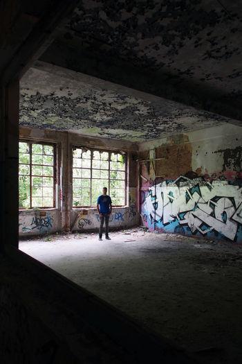 Full length of man standing in window