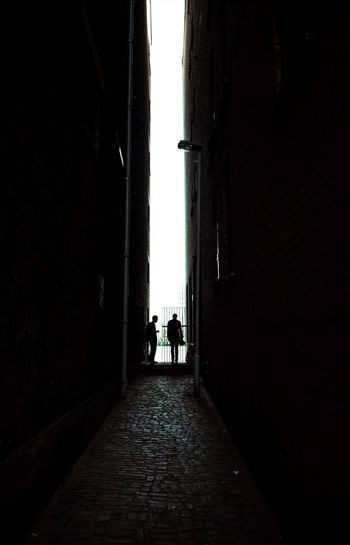 Cityscape NO SPACE Narrow Postcode Postcards Alley Alleyway Architecture Between Buildings Buildings Built Structure Everybodystreet Men Narrow Street Real People Rear View Silhouette Street Streetphotography The Way Forward Togetherness Two People Walking Walkway