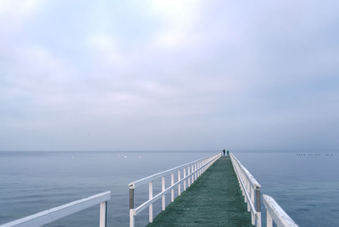 Unrecognizable people standing on sea dock on a misty cold winter afternoon. Afternoon Day Distance Dock Emptiness Empty Europe Horizon Lifestyle Loneliness Malmö, Sweden Mist Ocean People, Perspective Pier Sea Seaside Sky Water