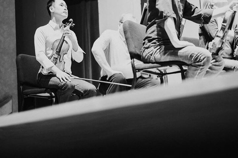 What Who Where Documenting a day in the life of talented musician and entrepreneur Kevin YU. Orchestra rehearsal. Violin Violonist Musician Classical Music Orchestra Rehearsal Man At Work White Shirt Coregami Performal Wear Documentary Photography
