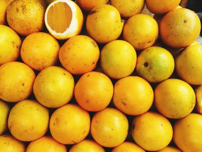 Orange Orange Food And Drink Healthy Eating Food Freshness Wellbeing Large Group Of Objects Fruit Citrus Fruit Yellow Abundance No People Full Frame Market For Sale Retail  Backgrounds Close-up Still Life High Angle View Lemon
