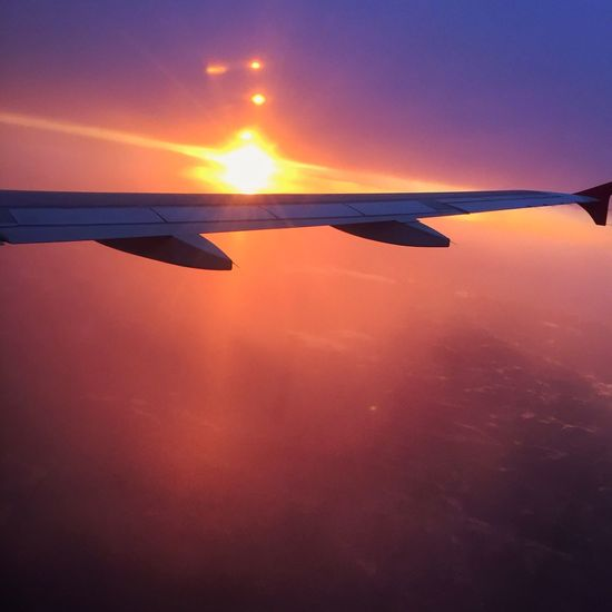 Flying Mode Of Transport Airplane Aircraft Wing Sunset Sky Mid-air Travel Airplane Wing EyeEm Best Shots Travel Photography IPhoneography Window Sunset_collection Sunset Silhouettes Sunsetporn Aviation Aviationphotography