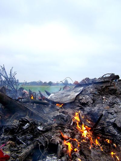 View of trash on fire against the sky