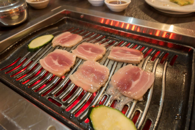 Belly pork cooking on a Korean barbeque. BBQ Cooking Cooking At Home Cusine Dinner Grilling Lunch Meal Authentic Belly Pork Close-up Food Food And Drink Freshness Griddle Grill High Angle View Indoors  Korean Barbecue Korean Barbeque Meat No People Restaurant SLICE Table